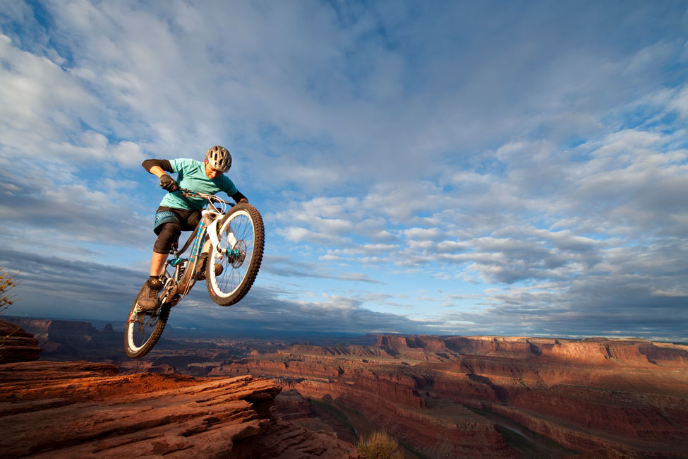 Joe-McNally-Ambassador-mountain-biker-over-canyon